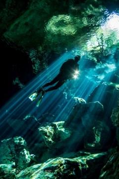 MAN IN A CAVE: Photographed at the Cenotes, Yucatan Peninsula, Mexico
