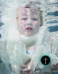 My little cousin Kile', underwater for the first time.